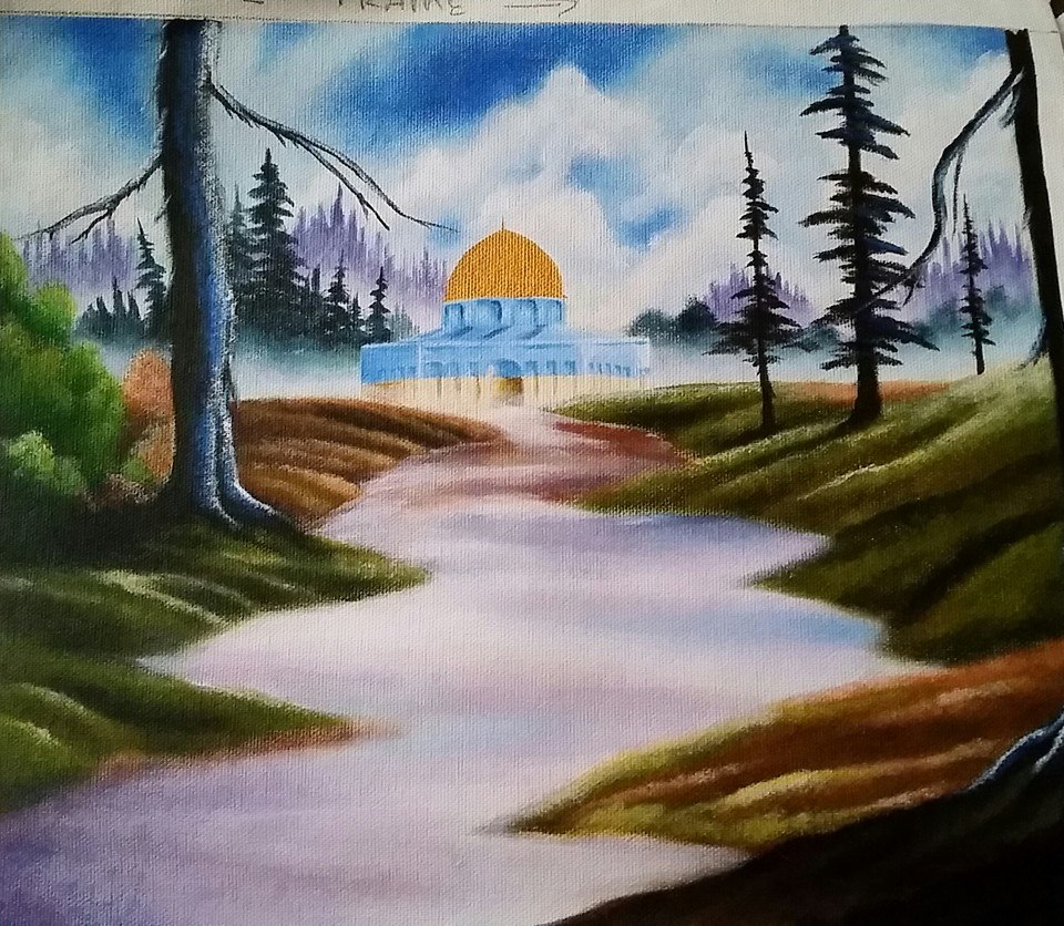 One of many gifts Adnan made and sent to us. This is a painting he made in prison on a shower curtain. Adnan would make crafts and gifts, handmade cards, for special occasions. Like the Eid holiday, or when I passed my bar exam, or when I had a baby.