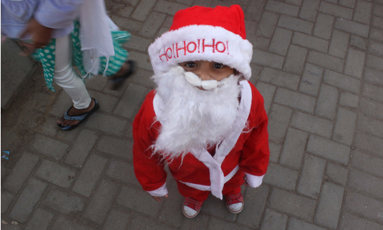 Pakistani boy dressed like Santa. Getty Images.