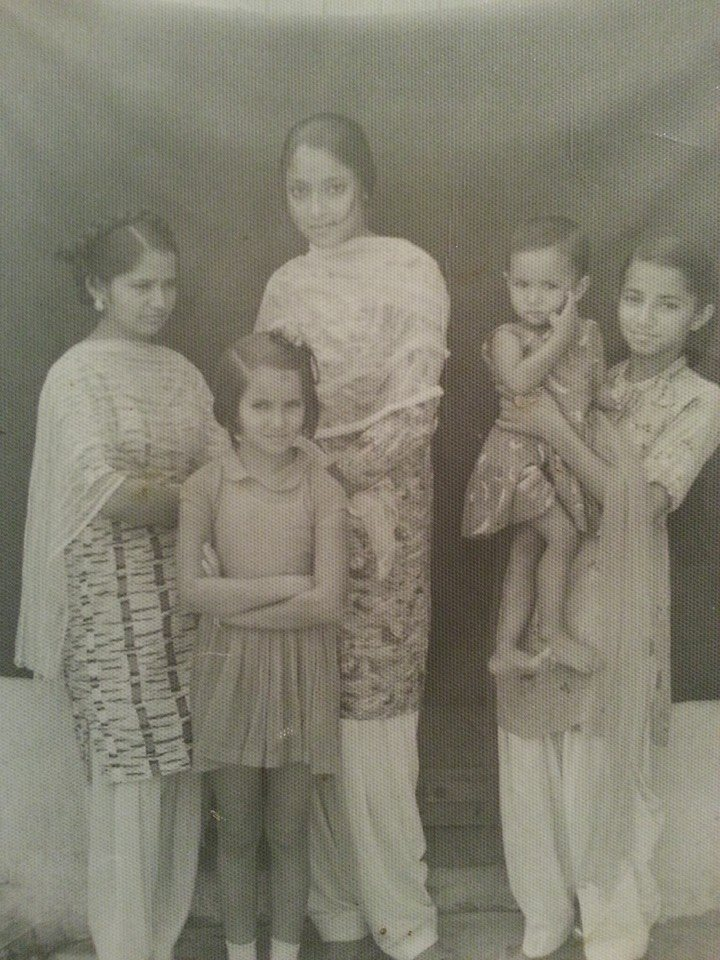 My mother, the tall girl in the center, with assorted siblings and cousins.